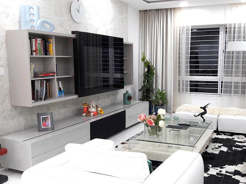 A modern living room decorated with glass furnishings and accessories in a monochrome color scheme.