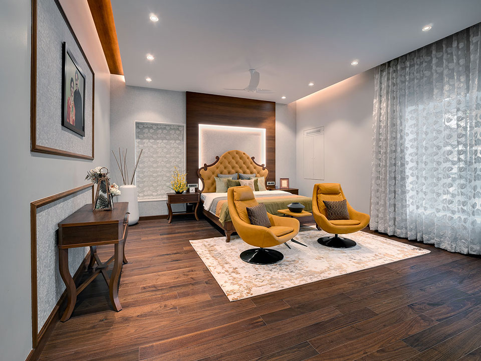 A well-lit bedroom whose interior has been styled with wooden furnishings and intricate lighting.